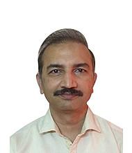Dr.  Manmohan Saini, Pediatrician