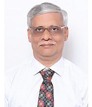 Dr.  Cajetan Tellis, Pediatrician